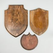 TWO LATE 19TH CENTURY WOODEN SHIELDS AND ONE LATER. Largest (h 39cm x w 28cm)