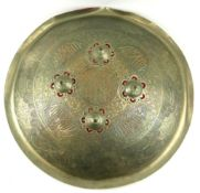 AN INDIAN WHITE METAL SPHERICAL SHIELD Mughal style inscriptions, four raised dome mounts and red