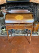 AN EDWARDIAN MAHOGANY AND MARQUETRY INLAID CYLINDER WRITING BUREAU Having a fitted interior above