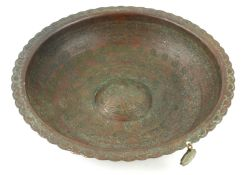 A COPPER ISLAMIC MAGIC MEDICINAL CIRCULAR BOWL With scrolled edge with engraved inscription