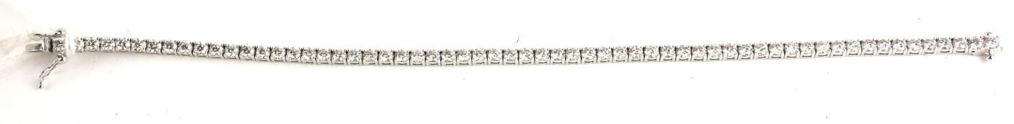 A WHITE GOLD AND DIAMOND TENNIS BRACELET Having a row of round cut diamonds. (approx total diamond