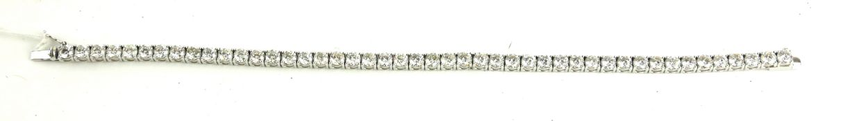 AN 18CT WHITE GOLD AND DIAMOND TENNIS BRACELET Having a single line of round cut diamonds. (approx