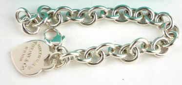 TIFFANY AND CO., A VINTAGE SILVER BRACELET The oval pierced links with heart form fob marked '