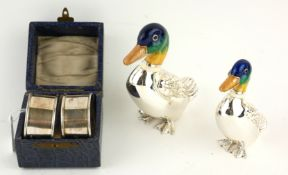 TWO WHITE METAL AND ENAMEL DUCK STATUES Having green and blue enamel decoration and embossed