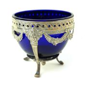 A LATE 19TH/EARLY 20TH CENTURY GERMAN SILVER AND BLUE GLASS SUGAR BOWL Classical form, with floral