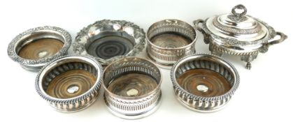 A PAIR OF EDWARDIAN SILVER PLATED WINE COASTERS Along with four 19th Century versions and a heavy