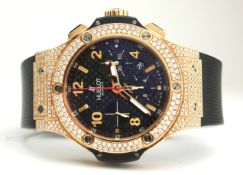 HUBLOT, BIG BANG, AN 18CT GOLD AND DIAMOND GENT'S CHRONOGRAPH WRISTWATCH With textured black dial,