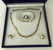 A VINTAGE 14CT GOLD AND OPAL JEWELLERY SUITE Comprising a necklace, ring and earrings each set