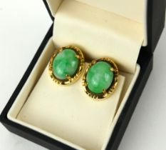 A PAIR OF 18CT GOLD AND OVAL JADE EARRINGS, CIRCA 1950.