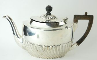 A VICTORIAN SILVER TEAPOT Having ebonised wood finial and handle and half flutes to body, with