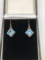 A PAIR OF 9CT GOLD, BLUE TOPAZ AND DIAMOND EARRINGS.