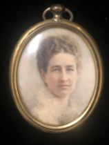AN EDWARDIAN OVAL PORTRAIT MINIATURE Young lady, inscribed verso, signed with initials 'A.G.,