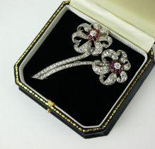 AN 18CT WHITE GOLD, RUBY AND DIAMOND FLORAL SPRAY BROOCH, CIRCA 1890. (6.5cm x 5cm)