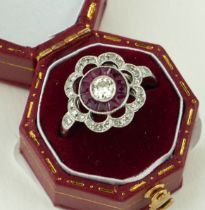 AN 18CT WHITE GOLD, RUBY AND DIAMOND FLOWER RING (size M½).