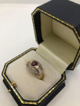 A 14CT GOLD, RUBY AND DIAMOND RING, CIRCA 1970 Pavé set with brilliant and baguette cut diamonds (