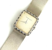 CHOPARD FOR TIFFANY AND CO., AN 18CT WHITE GOLD, DIAMOND AND SAPPHIRE LADIES' WRISTWATCH The