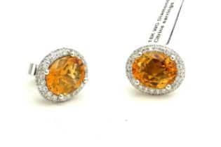 A PAIR OF 18CT WHITE GOLD, OVAL CITRINE AND DIAMOND EARRINGS. (1.3cm, 6.9g)