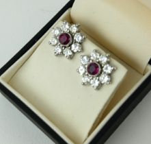 A PAIR OF 18CT WHITE GOLD, RUBY AND DIAMOND CLUSTER EARRINGS. (ruby approx 1.01ct, diamond approx