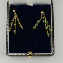 A PAIR OF 9CT GOLD AND TSAVORITE GREEN GARNET EARRINGS.