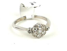AN 18CT WHITE GOLD, PLATINUM AND OLD BRILLIANT CUT DIAMOND DAISY CLUSTER RING (size I). (2.2g)