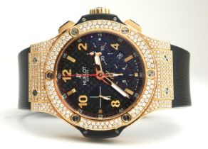 HUBLOT, BIG BANG, AN 18CT GOLD AND DIAMOND GENT'S CHRONOGRAPH WRISTWATCH With textured black dial,