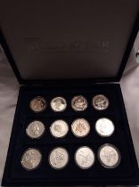 A COLLECTION OF SILVER WORLD AT WAR PROOF COINS Comprising seven twenty crown coins, four one