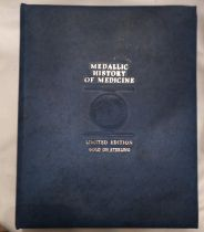 A 24CT GOLD ON SILVER MEDALLIC HISTORY OF MEDICINE PROOF COIN SET Complete sixty-six coins in
