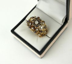 AN 18CT GOLD, SAPPHIRE AND DIAMOND BOMBE RING, CIRCA 1950. (size N).