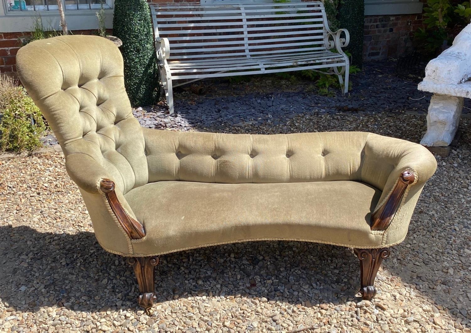 A VICTORIAN MAHOGANY FRAMED TWO SEAT WINDOW CHAISE LOUNGE Button back green velvet upholstery. (