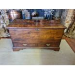 AN 18TH CENTURY OAK MULE CHEST The rise and fall top above two drawers, fitted with brass escutcheon