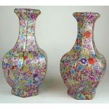 A PAIR OF CHINESE PORCELAIN FLORAL VASES Decorated with multi flowers on yellow ground with jade
