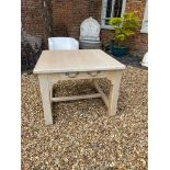 A 20TH CENTURY LIMED OAK PREPARATION TABLE The single drawer raised on heavy square chamfered legs