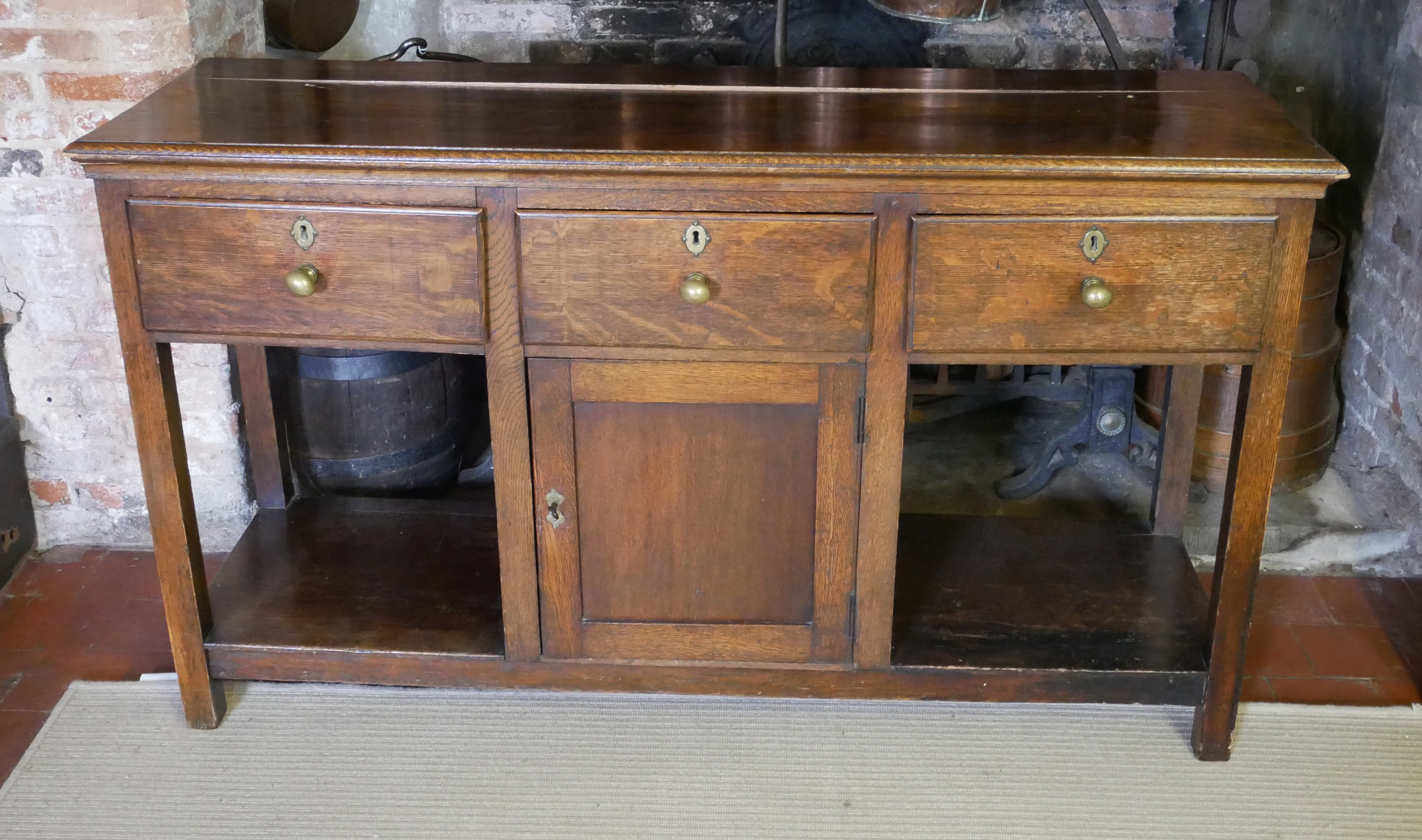 A 19TH CENTURY OAK DRESSER With three drawers above a central cupboard, on square legs. (152cm x