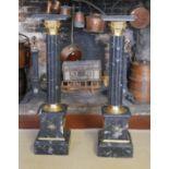 A PAIR OF REGENCY DESIGN BLACK MARBLE AND GILT METAL JARDINIÈRE STANDS. (27cm x 27cm x 102cm)