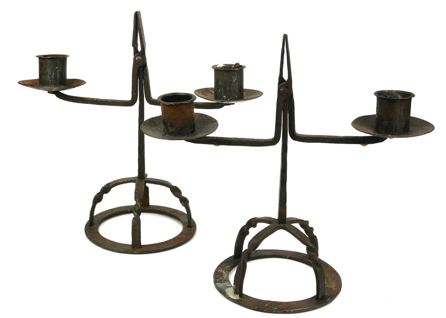 A RARE PAIR OF 17TH/18TH CENTURY WROUGHT IRON TWIN BRANCH RUSH CANDELABRA. (35cm x 32cm)
