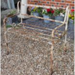 A 19TH CENTURY WROUGHT IRON STRAPWORK GARDEN BENCH Having scrolled arms and white painted finish. (