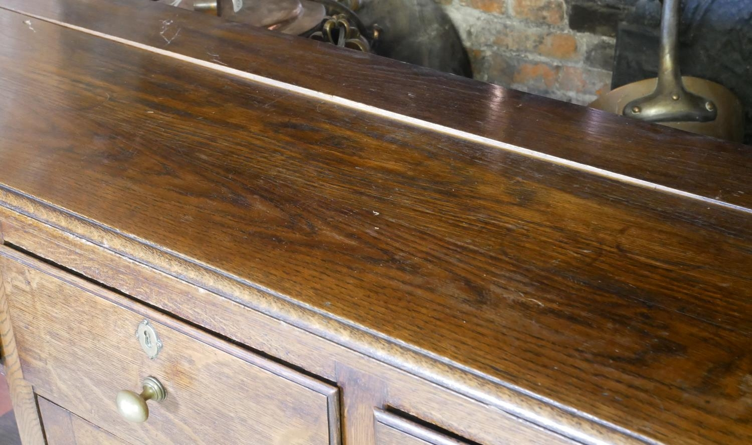 A 19TH CENTURY OAK DRESSER With three drawers above a central cupboard, on square legs. (152cm x - Image 3 of 7