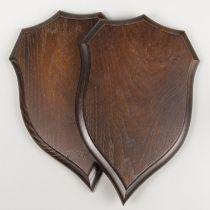 A PAIR OF ROWLAND WARD CARVED OAK REPLICA SHIELDS. Exceptional quality replicas of an original