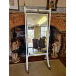 A 19TH CENTURY CHEVAL MIRROR The later white painted frame with turned finials and columns holding a