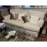 A PAIR OF GOOD QUALITY THREE SEATER SOFAS Upholstered in a cut cream fabric, complete with loose