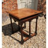 LIBERTY & CO. LTD, LONDON, A MAHOGANY CENTRE TABLE The square top above a shaped apron, raised on