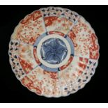 A 19TH CENTURY JAPANESE IMARI PORCELAIN CHARGER PLATE Chrysanthemum form with underglaze blue and