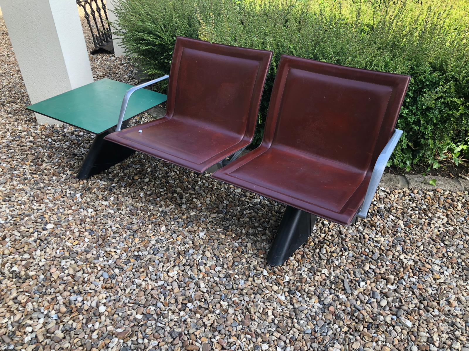 AN ITALIAN STEEL, ALUMINIUM AND LEATHER TWO SEATER BENCH Brown leather covers with aluminium