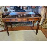 A VICTORIAN MAHOGANY WRITING TABLE With galleried back above three drawers, raised on turned