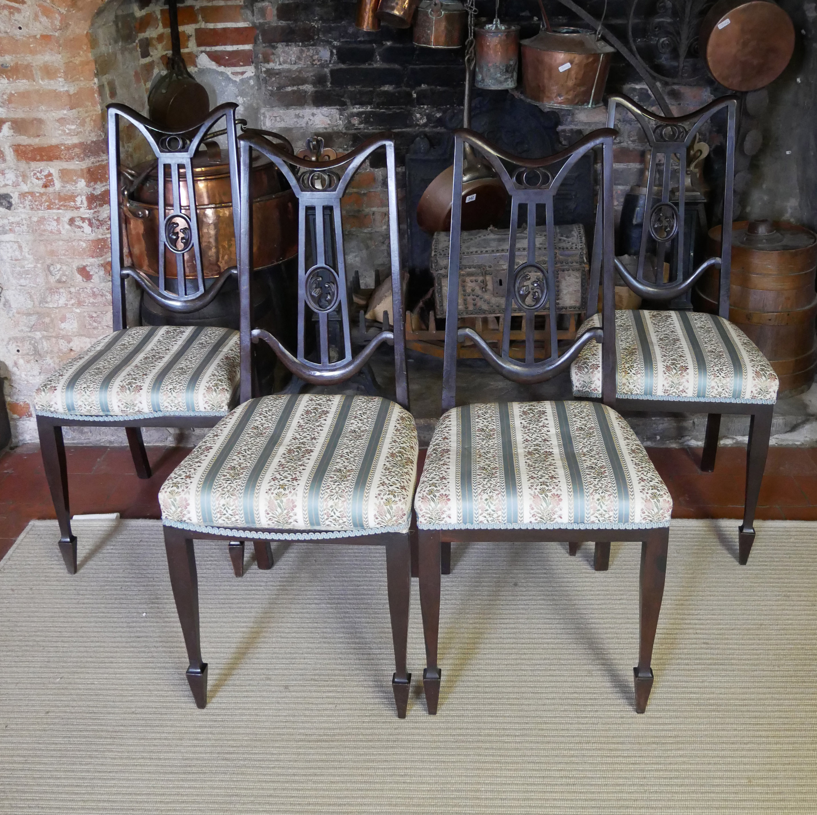 A SET OF FOUR ART NOVEAU PERIOD AND DESIGN MAHOGANY SALON CHAIRS With overstuffed upholstered seats,