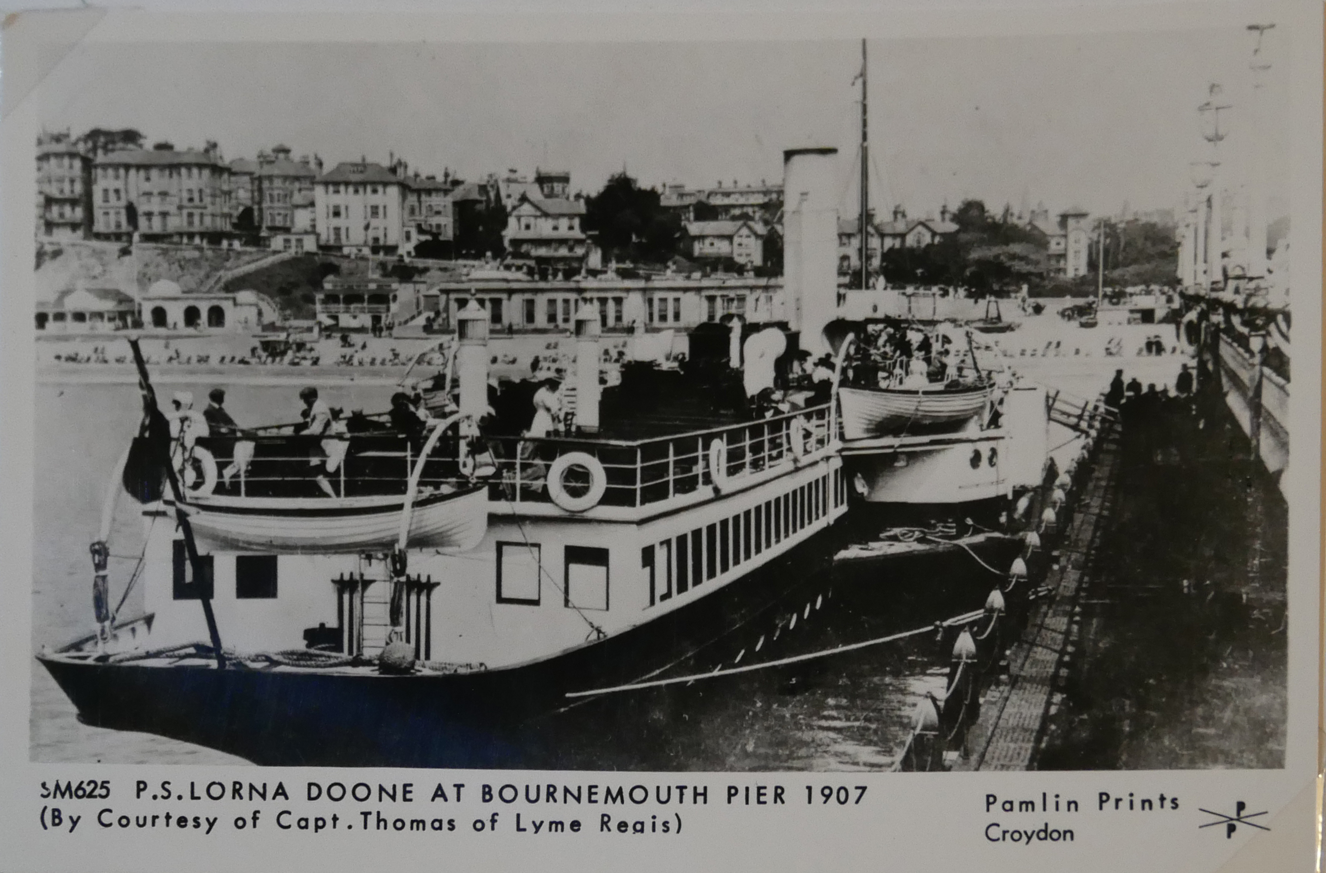 AN ALBUM OF BLACK AND WHITE PHOTOGRAPHIC POSTCARDS OF STEAM SHIPS Issued by Pamlin Prints, including