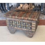 AN INDIAN BRASS AND SHEESHAM WOOD DOMED TOPPED CHEST ON WHEELS. (40cm x 53cm x 41cm) Condition: good