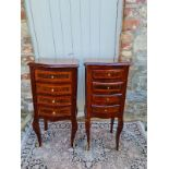 A PAIR OF CONTINENTAL LACQUERED WALNUT BOW FRONTED PEDESTAL CHESTS With four drawers, on cabriole