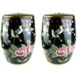 A PAIR OF 20TH CENTURY FAMILLE NOIR STYLE PORCELAIN GARDEN BARREL SEATS Painted with birds and