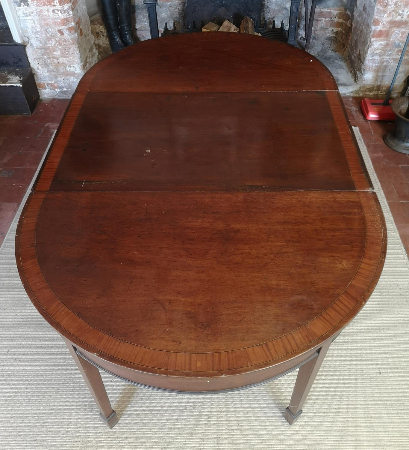 A 19TH CENTURY MAHOGANY AND CROSSBANDED 'D' END DINING TABLE With one extra leaf, raised on square - Image 3 of 4